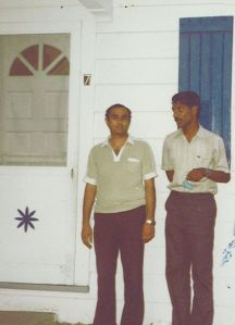 With my friend Kumar (left) in front of a motel we stayed at
